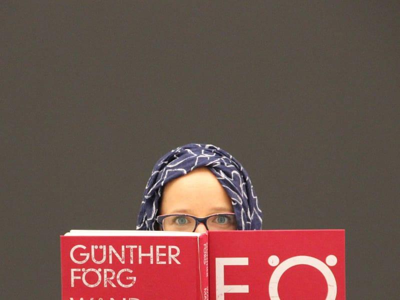 Woman in Hijab Reading