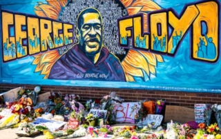 Beautiful yellow and blue graffiti mural in Chicago honoring George Floyd.