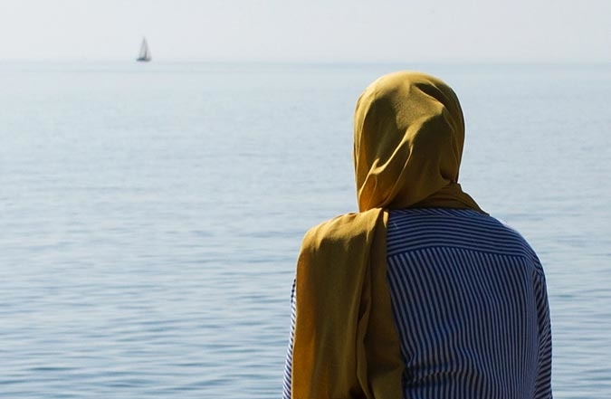 Muslim Woman Gazing at Ocean